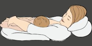 אישה מניקה תינוק